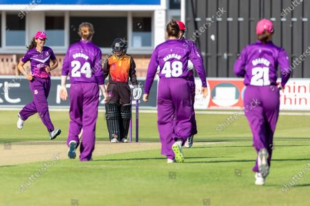 Stock Photo of WICKET - Gwenan Davies is caught behind by Abbey Freeborn (wkt) during the Rachael Heyhoe Flint Trophy match between Loughborough Lightning and Central Sparks at the Fischer County Ground, Grace Road, Leicester