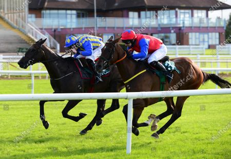 Stock Picture of Navan SUNDRENCHED and Liam McKenna (far) win for owner Michael Dunlop and trainer James Lambe. Healy Racing