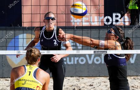 Marta Menegatti (R) and Viktoria Orsi Toth (C) of Italy in action during their women's third round match against Nadezda Makroguzova (L) and Svetlana Kholomina of Russia at the 2020 CEV Beach Volleyball European Championships in Jurmala, Latvia, 19 September 2020.