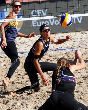 Marta Menegatti (C) and Viktoria Orsi Toth (front) of Italy in action during their women's third round match against Nadezda Makroguzova (L) and Svetlana Kholomina of Russia at the 2020 CEV Beach Volleyball European Championships in Jurmala, Latvia, 19 September 2020.