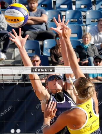 Stock Image of Viktoria Orsi Toth (L) of Italy in action against Svetlana Kholomina (R) of Russia during their women's third round match at the 2020 CEV Beach Volleyball European Championships in Jurmala, Latvia, 19 September 2020.