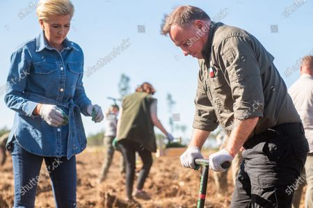 President of Poland Andrzej Duda and his wife Agata Kornhauser Duda are seen planting trees at the Lipusz Forest District. The #sadziMY campaign was held for the second time in all forest districts. In the previous year, foresters distributed seedlings to volunteers. The initiator of the nationwide campaign was President Andrzej Duda, who together with his wife Agata Kornhauser-Duda planted young trees in the Lipusz Forest District in Gdansk, an area damaged by a hurricane in 2017.