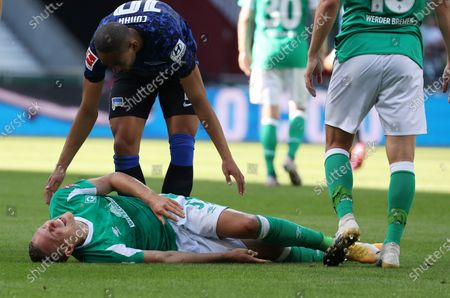 Bremen's Ludwig Augustinsson (bottom) reacts after being tackled during the German Bundesliga soccer match between SV Werder Bremen and Hertha BSC Berlin in Bremen, Germany, 19 September 2020.