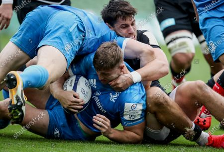 Leinster vs Saracens. Leinster's Jordan Larmour is tackled by Sean Maitland of Saracens
