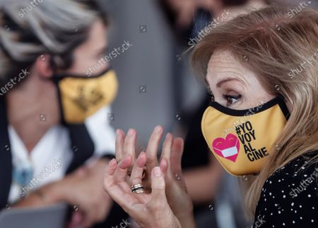 A woman wears a face mask reading 'I also go to the cinema' during the awarding ceremony of the National Film Prize for 2020 to Spanish film director and screenwriter Isabel Coixet (unseen) at the 68th annual San Sebastian International Film Festival (SSIFF), in San Sebastian, Spain, 19 September 2020. The film festival will run from 18 to 26 September 2020 under safety measures like obligatory face mask use and red carpets without public due to the Covid-19 coronavirus pandemic. Organizers have also reduced the number of film screenings as well as the seating capacity in cinemas.