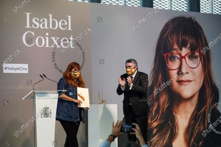Isabel Coixet (L) receives the National Film Prize for 2020 from Spanish Sports and Culture Minister Jose Manuel Rodriguez Uribes (R) at the 68th annual San Sebastian International Film Festival (SSIFF), in San Sebastian, Spain, 19 September 2020. The film festival will run from 18 to 26 September 2020 under safety measures like obligatory face mask use and red carpets without public due to the Covid-19 coronavirus pandemic. Organizers have also reduced the number of film screenings as well as the seating capacity in cinemas.