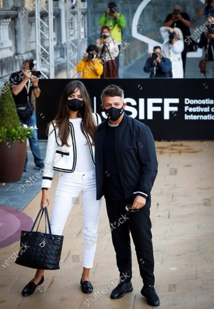 Alejandro Sanz (R) and his girlfriend, Cuban artist Rachel Valdes, pose upon their arrival to the hotel where the guests are lodged during 68th San Sebastian International Film Festival (SSIFF) in San Sebastian city, Basque country, northern Spain, 19 September 2020. The film festival will run from 18 to 26 September 2020 under safety measures like obligatory face mask use and red carpets without public due to the Covid-19 coronavirus pandemic. Organizers have also reduced the number of film screenings as well as the seating capacity in cinemas.