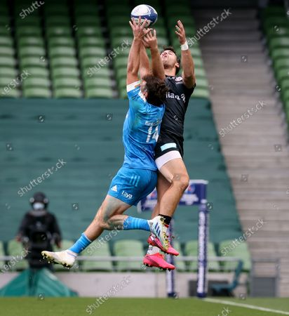 Leinster vs Saracens. Leinster's Hugo Keenan competes in the air with Sean Maitland of Saracens