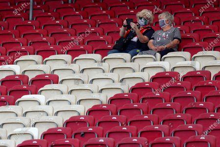 Stuttgart fans wait for the start of the German Bundesliga soccer match between VfB Stuttgart and SC Freiburg, Germany, . 8500 spectators are allowed to watch the game in the stadium