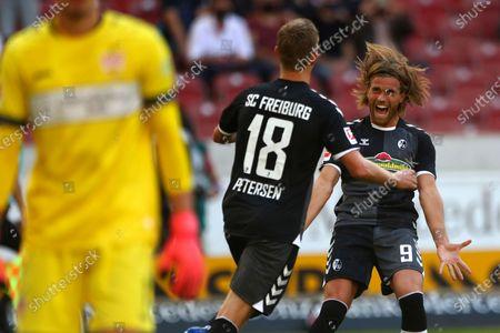 Freiburg's Lucas Hoeler, right, celebrates after team mate Nils Petersen, left, scored his side's opening goal during the German Bundesliga soccer match between VfB Stuttgart and SC Freiburg, Germany