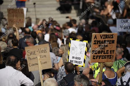 "Stock Image of People hold placards including one portraying Bill Gates as they take part in a ""Resist and Act for Freedom"" protest against a mandatory coronavirus vaccine, wearing masks, social distancing and a second lockdown, in Trafalgar Square, London"