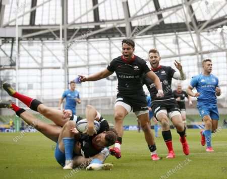 Saracens players Sean Maitland and Elliot Daly celebrate as Alex Goode scores the opening Try of the game