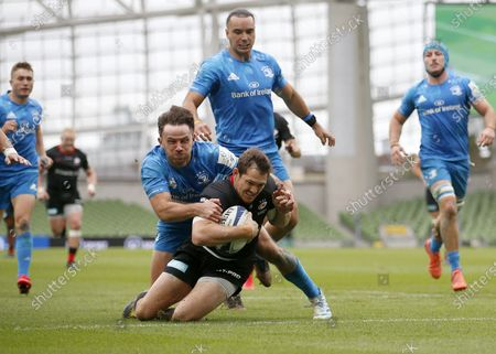 Alex Goode beats Hugo Keenan of Leinster to score the opening Try of the game for Saracens