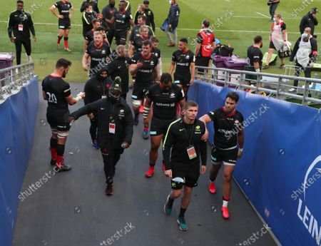 Owen Farrell (bottom right) with Saracens teammate Sean Maitland as the team leave the pitch victorious
