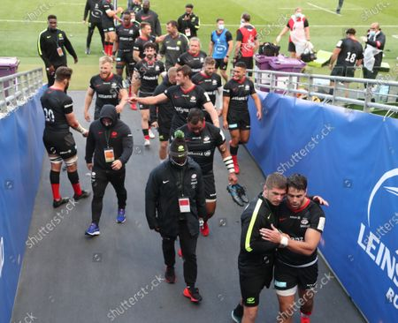 Owen Farrell (bottom right) hugs Saracens teammate Sean Maitland as the team leave the pitch victorious