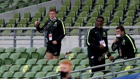 Owen Farrell (left) and Joel Kpoku, two of Saracens no playing travelling contingent celebrate after Alex Goode had kicked the match clinching penalty goal