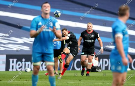 Alex Goode of Saracens kicks the match clinching penalty goal for Saracens