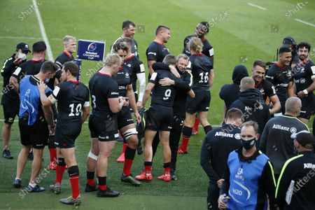 Stock Image of Mark McCall the Saracens director of rugby hugs number 9 Richard Wigglesworth as the team celebrate their victory