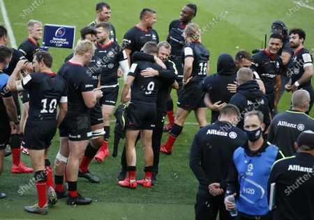 Mark McCall the Saracens director of rugby hugs scrum half Richard Wigglesworth after the game