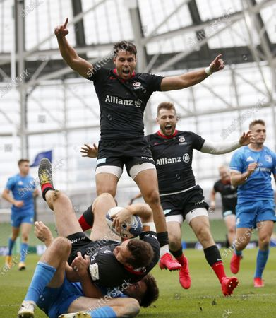 Sean Maitland and Elliot Daly celebrate Saracens Try scored by Alex Goode
