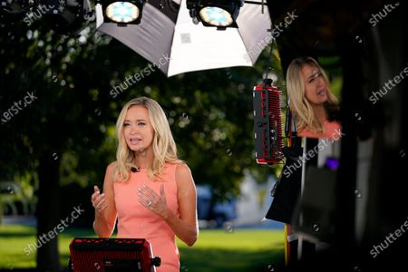 White House press secretary Kayleigh McEnany speaks during a television news interview outside the White House, in Washington