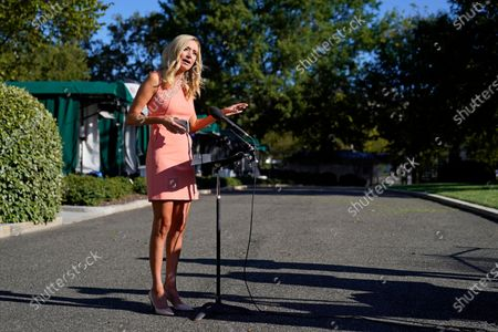 White House press secretary Kayleigh McEnany speaks with reporters after participating in a television news interview outside the White House, in Washington