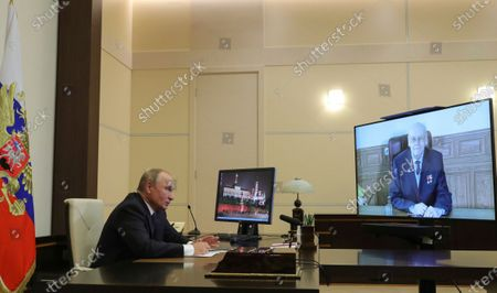 "Stock Photo of Russian President Vladimir Putin attends a meeting with honorary chief designer of Joint stock company ""Military and industrial corporation JSC ""MIC ""Mashinostroyenia"" Herbert Efremov via video conference at the Novo-Ogaryovo residence outside Moscow, Russia"