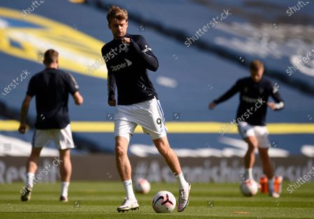 Leeds United's Patrick Bamford, centre, controls the ball during warmup before the English Premier League soccer match between Leeds United and Fulham at Elland Road Stadium, in Leeds, England