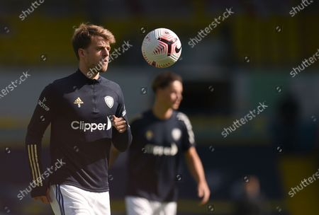 Leeds United's Patrick Bamford, front, controls the ball during warmup before the English Premier League soccer match between Leeds United and Fulham at Elland Road Stadium, in Leeds, England