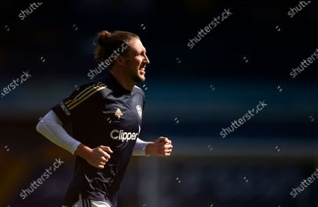 Leeds United's Luke Ayling runs during warmup before the English Premier League soccer match between Leeds United and Fulham at Elland Road Stadium, in Leeds, England