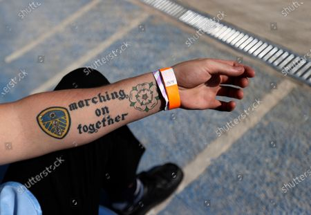 View of a stewards tattoo before the English Premier League soccer match between Leeds United and Fulham at Elland Road Stadium, in Leeds, England