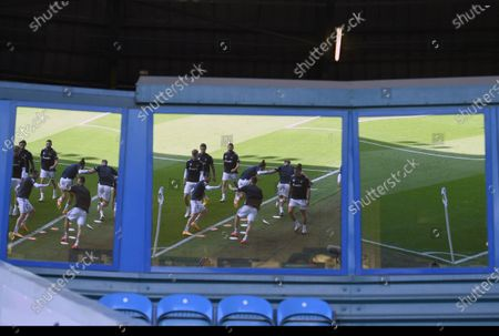 Stock Picture of Leeds players reflected in a window during warmup before the English Premier League soccer match between Leeds United and Fulham at Elland Road Stadium, in Leeds, England