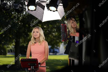 White House press secretary Kayleigh McEnany participates in a television news interview outside the White House, in Washington
