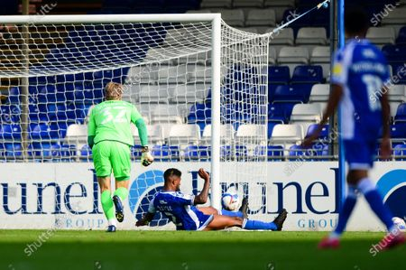 Mark Little of Bristol Rovers clears the ball off the line