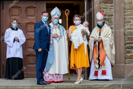 Hereditary Grand Duchess Stephanie (3-L) of Luxembourg and Hereditary Grand Duke Guillaume (2-L) of Luxembourg with their son Prince Charles of Luxembourg pose with Cardinal Jean-Claude Hollerich (3-L) prior to the baptism of Prince Charles at the Benedictine Abbey of Saint-Maurice in Clervaux, Luxembourg, 19 September 2020. HRH Prince Charles Jean Philippe Joseph Marie Guillaume of Luxembourg was born on 10 May 2020 in Luxembourg