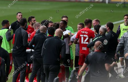 Swansea Assistant Manager Alan Tate being pushed away by Birmingham City Manager Aitor Karanka and players after his confrontation with Jon Toral of Birmingham at half time.