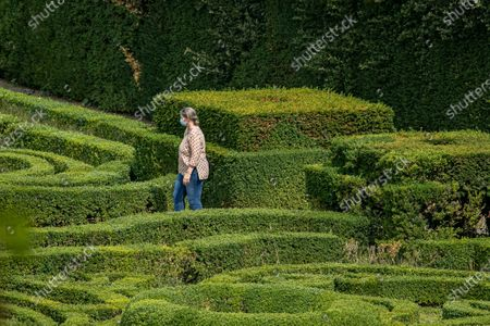 Visitors walk through the mannerist garden in Villa Lante designed by architectet Jacopo Barozzi da Vignola bathed in autumn sunshine. Vill Lante was used as a filming location  the TV series The Young Pope in 2016 directed by Paolo Sorentino