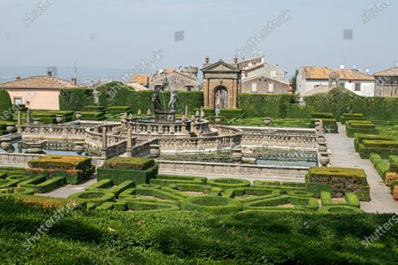 Stock Photo of The mannerist garden in Villa Lante designed by architectet Jacopo Barozzi da Vignola bathed in autumn sunshine. Vill Lante was used as a filming location  the TV series The Young Pope in 2016 directed by Paolo Sorentino