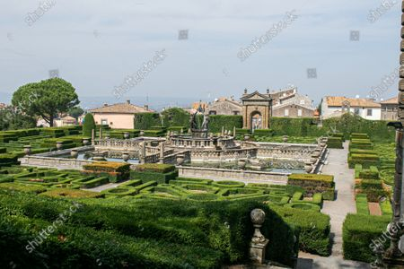 Stock Picture of The mannerist garden in Villa Lante designed by architectet Jacopo Barozzi da Vignola bathed in autumn sunshine. Vill Lante was used as a filming location  the TV series The Young Pope in 2016 directed by Paolo Sorentino
