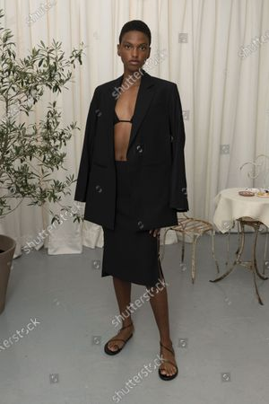 Stock Image of A Model wearing an outfit from the Womens Ready to wear, pret a porter, collections, summer 2021, original creation, during the Womenswear Fashion Week in London, from the house of Eudon Choi