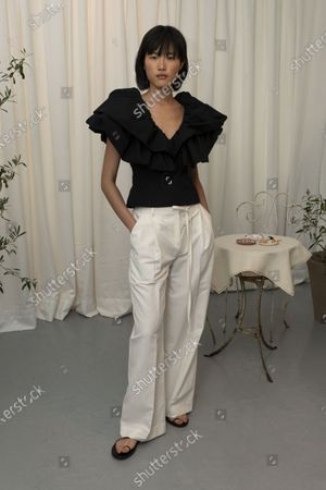 Stock Photo of A Model wearing an outfit from the Womens Ready to wear, pret a porter, collections, summer 2021, original creation, during the Womenswear Fashion Week in London, from the house of Eudon Choi