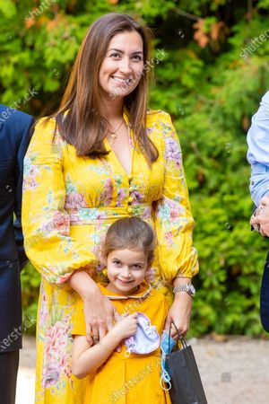 Princess Claire of Luxembourg and Princess Amalia during the christening of Prince Charles of Luxembourg, at Abbaye Saint-Maurice in Clervaux, Luxembourg.