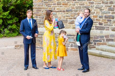 Prince Felix and Princess Claire of Luxembourg with their children Princess Amalia and Prince Liam and Prince Louis of Luxembourg during the christening of Prince Charles of Luxembourg, at Abbaye Saint-Maurice in Clervaux, Luxembourg.