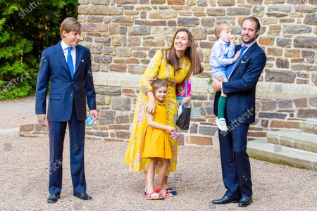 Stock Image of Prince Felix and Princess Claire of Luxembourg with their children Princess Amalia and Prince Liam and Prince Louis of Luxembourg during the christening of Prince Charles of Luxembourg, at Abbaye Saint-Maurice in Clervaux, Luxembourg.