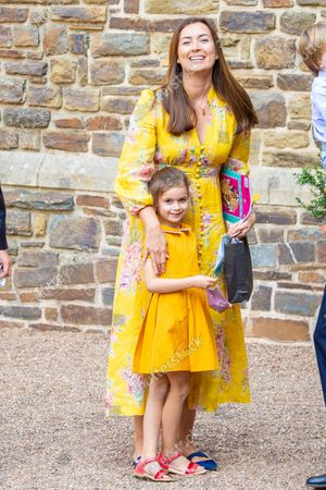 Stock Photo of Princess Claire of Luxembourg and Princess Amalia during the christening of Prince Charles of Luxembourg, at Abbaye Saint-Maurice in Clervaux, Luxembourg.