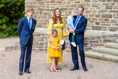 Stock Picture of Prince Felix and Princess Claire of Luxembourg with their children Princess Amalia and Prince Liam and Prince Louis of Luxembourg during the christening of Prince Charles of Luxembourg, at Abbaye Saint-Maurice in Clervaux, Luxembourg.