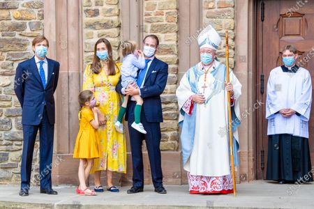 Stock Picture of Prince Felix and Princess Claire of Luxembourg with their children Princess Amalia and Prince Liam and Prince Louis of Luxembourg with the pope during the christening of Prince Charles of Luxembourg, at Abbaye Saint-Maurice in Clervaux, Luxembourg.