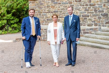 Stock Image of Grand Duke Henri of Luxembourg and Grand Duchess Maria Teresa of Luxembourg with Prince Sebastien of Luxembourg during the christening of Prince Charles of Luxembourg, at Abbaye Saint-Maurice in Clervaux, Luxembourg.