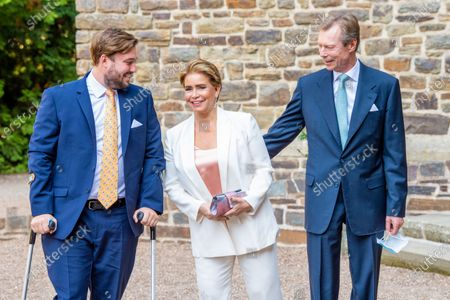 Stock Picture of Grand Duke Henri of Luxembourg and Grand Duchess Maria Teresa of Luxembourg with Prince Sebastien of Luxembourg during the christening of Prince Charles of Luxembourg, at Abbaye Saint-Maurice in Clervaux, Luxembourg.