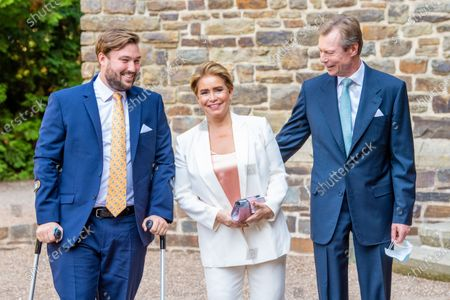 Grand Duke Henri of Luxembourg and Grand Duchess Maria Teresa of Luxembourg with Prince Sebastien of Luxembourg during the christening of Prince Charles of Luxembourg, at Abbaye Saint-Maurice in Clervaux, Luxembourg.